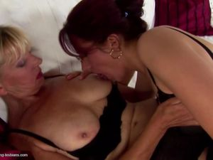 Granny and MILF fuck and piss on each..