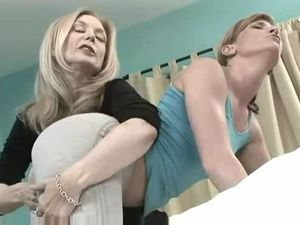 Nina Hartley and Ariel in hot strap on..