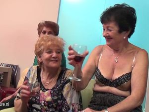 Old and young lesbians perform in a room..