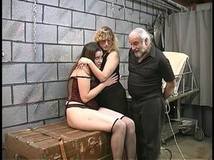 Two cute basement bdsm lesbians make out..