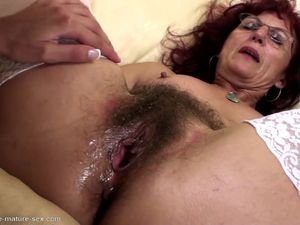 Hairy mom gets deep fisting from young..