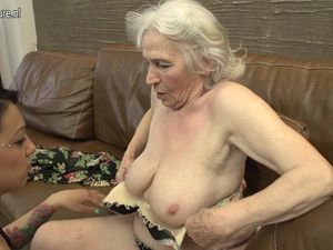 Hairy granny getting licked by young girl